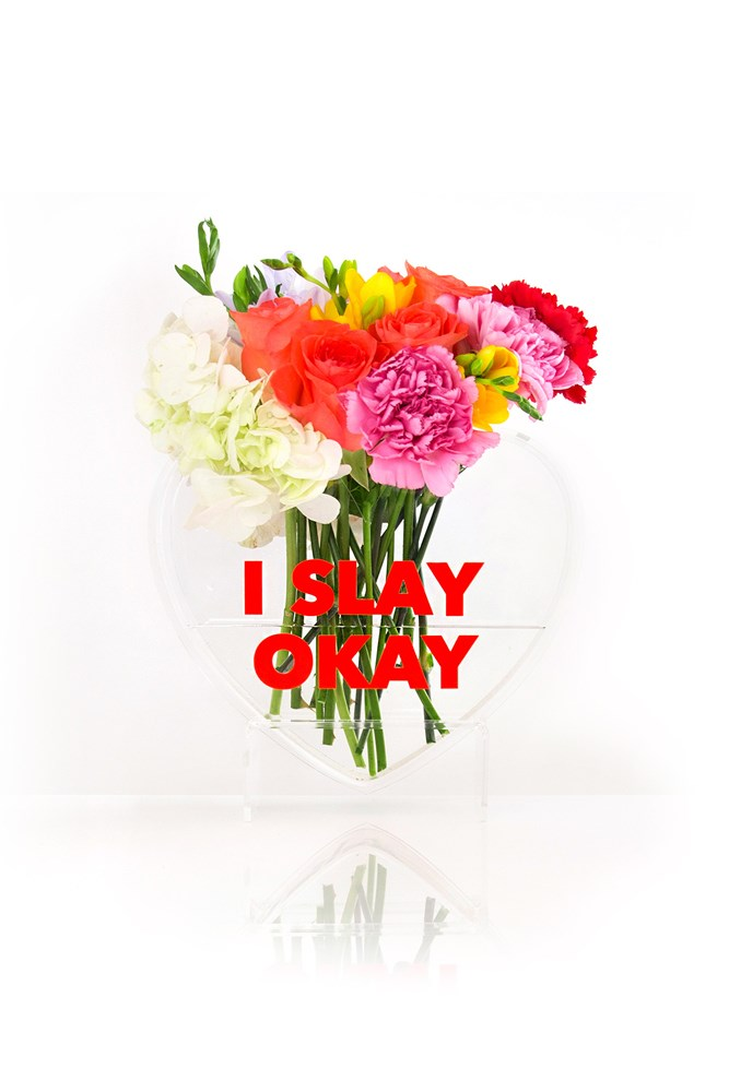 "<a href=""https://lovestar.com.au/collections/all/products/i-slay-okay-queen-of-hearts-heart-vase"">Love Star I Slay Okay Vase</a>, $99."