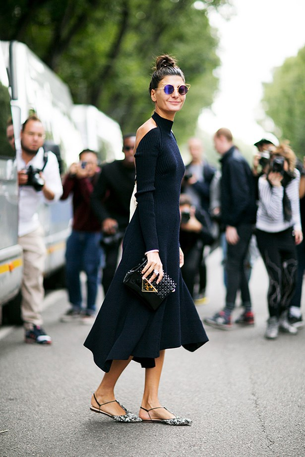 """One sure way to loosen up a serious dress? Team it with free-spirited flats and downplay things further with a topknot and fun eyewear."""