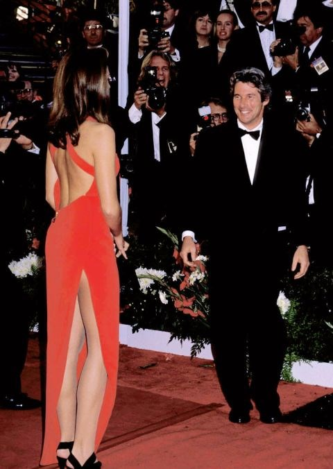 <p><strong>CINDY CRAWFORD, 1991</strong><p><p> ...and a high slit in the back. It was widely copied at the time and is now considered one of the most iconic red carpet dresses ever.