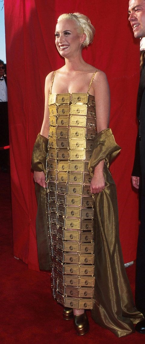 <p><strong>LIZZIE GARDINER, 1995</strong><p><p> Fact: Lizzie Gardiner won an Oscar in 1995 for Best Costume Design. Fact: Gardiner also designed this dress made of 254 expired American Express Gold cards. She originally created the dress for the film Priscilla, Queen of the Desert but ultimately couldn't use it in the movie because American Express didn't approve. After Gardiner wore the dress to the Oscars though, AmEx bought the dress.
