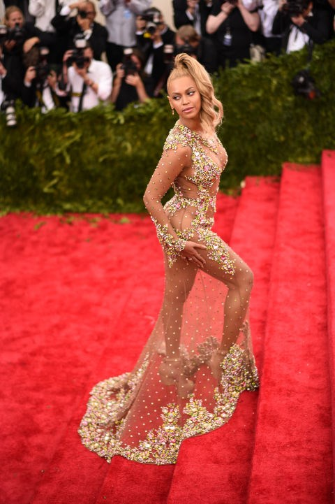 <p><strong>BEYONCÉ, 2015</strong><p><p> In 2014, the news out of the Met Gala was all about Beyoncé and the elevator incident. For her return to the event the next year (with Jay Z by her side), Bey wore this sheer embellished Givenchy gown designed by Riccardo Tisci — possibly referencing a scene from Coming to America — and started a new conversation.