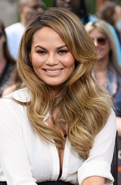 <strong>Hack #4: Waves in five.</strong><br><br> Chrissy Teigen loves a lazy-girl life hack as much as the rest of us so it makes total sense that her mane man David Lopez came up with the greatest style hack of all time. Spray in some texturiser, twist your hair into a rope-style braid (two if you're blessed with thick hair like CT) and blast-dry. Now you're ready to eat some pizza and tweet like a boss.