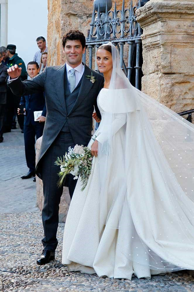 </p><p>The bride wore a structured wool Emilia Wickstead gown, topped off with an embroidered cathedral-length veil and deep emerald-green pumps.