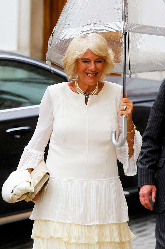 </p><p>Duchess of Cornwall Camilla Parker Bowles attended (sans Charles, Kate, and Wills) wearing tiered chiffon – and was seemingly the only person who prepared for the inclement weather accordingly.