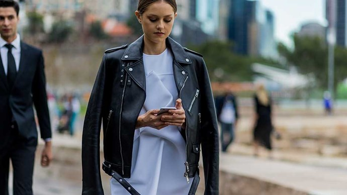 Isabelle Cornish wearing a white Toni Maticevski dress, a black Burberry leather jacket during Mercedes Benz Fashion Week Australia