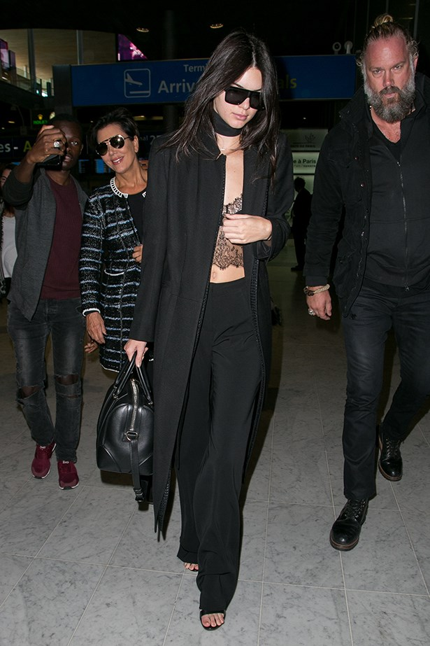 <P> <strong>UNDER A COAT.</strong><p> <p> As demonstrated by her Coachella moment, the bralette can be worn as a top by itself. Kendall threw it on under a long black duster with a choker and some wide-leg pants.