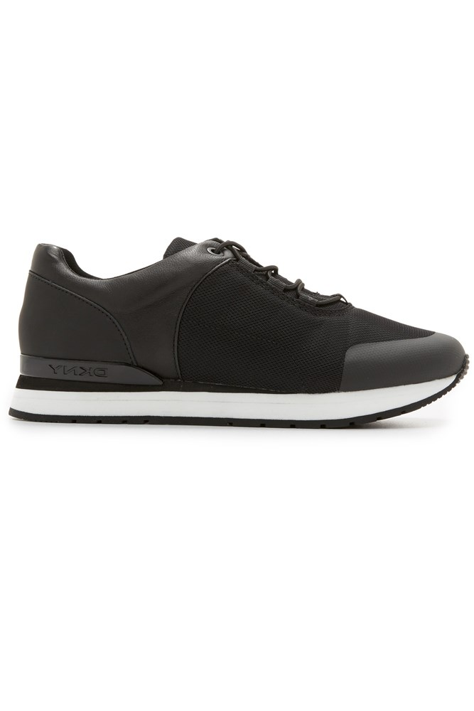 "<strong>Black-on-black</strong><br><br> <a href=""https://www.shopbop.com/jaxone-runner-dkny/vp/v=1/1566794898.htm"">Sneakers, $158, DKNY</a>"