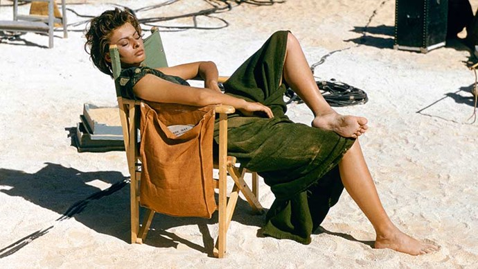 Italian actress Sophia Loren relaxes on the Libyan set of the desert adventure film 'Legend of the Lost', 1957.