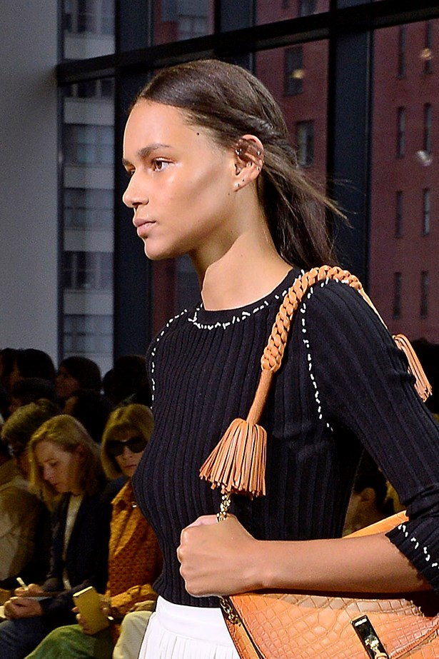 <P>CAPRICORN<p> <p> You're a perfectionist with patience, which means high-maintenance styles are your forte. <p> <p> It won't take you long to master the glossy plait spotted at Celine. Or the deep V braid seen at Altuzarra. Grab two sections of hair at the front and twist back away from the face. Secure with a clear elastic.