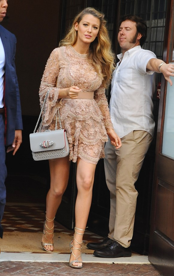 Blake demonstrated she's still got it in the princess department with this blush sparkly dress, which she paired with sky-high heels and a grey handbag.