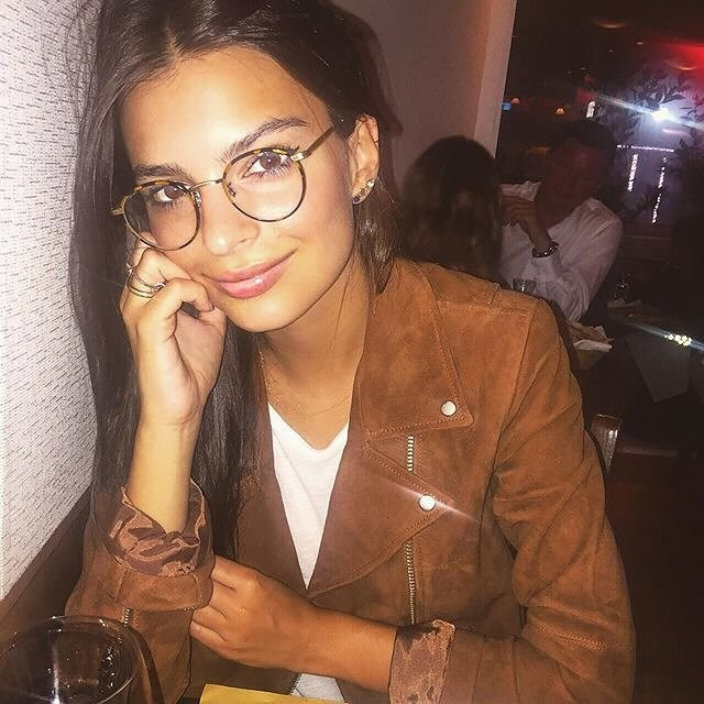 "Emily Ratajkowski prefers to go light on the frames, with a tortoise shell edge. Hers are <a href=""http://www.garrettleight.com/eyeglasses/wilson/?130=95"">Garrett Leight's 'Wilson'</a>."