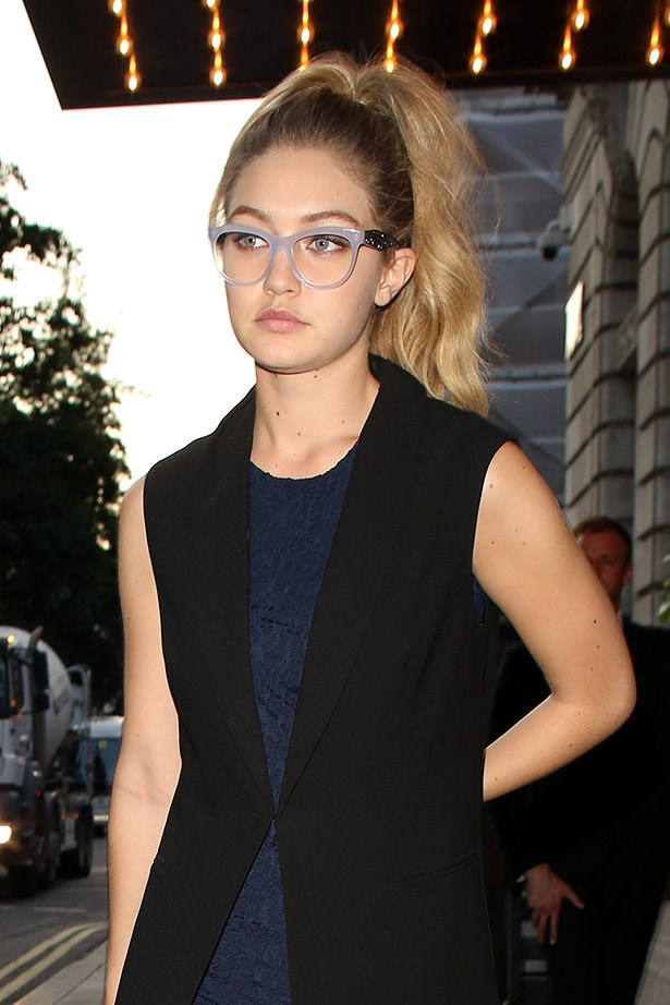 Her sister Gigi prefers a light-blue pair, these are Miu Miu 08NV Glasses.