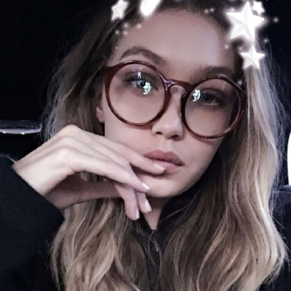 Gigi also has a pair of rounder glasses (Snapchat star filter not included).