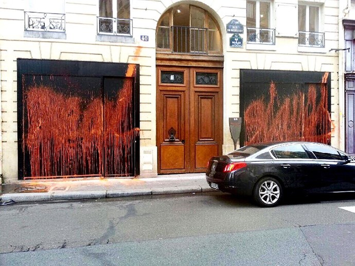 Kidult vandalises Kanye West Life of Pablo pop-up store in Paris.