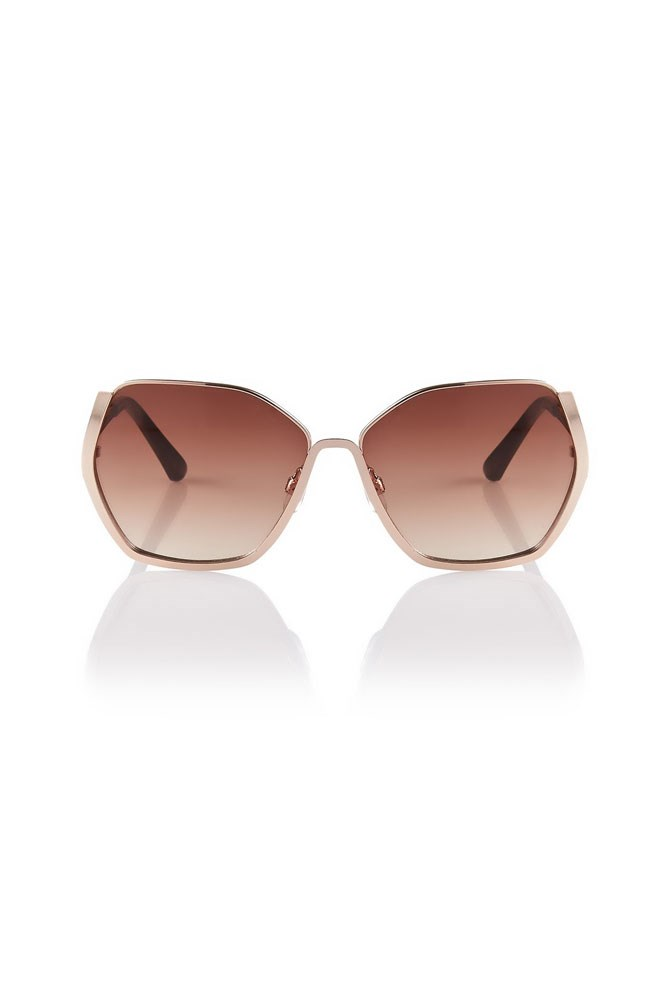"Festival muse: Edie Campbell<br><br> <a href=""http://www.sportsgirl.com.au/accessories/sunglasses/whirlwind-gold-sunglasses-gold-all"">Sunglasses, $39.95, Sportsgirl</a>"