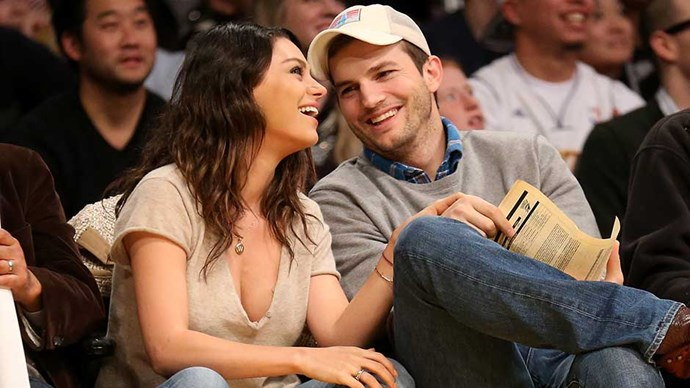 Actors Ashton Kucher and Mila Kunis attend the game between the Oklahoma City Thunder and the Los Angeles Lakers at Staples Center