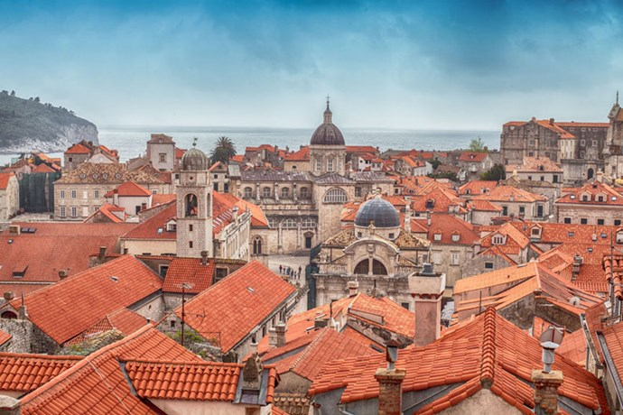 <strong>GO VISIT: DUBROVNIK, CROATIA</strong> <br><br> Though King's Landing scenes have been filmed in multiple locations, Dubrovnik seems to resemble the fictional capital the most, especially with its red terra cotta rooftops. Fellow Croatian city Split, a three hour drive north, is a close second.