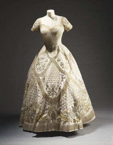 </p><p><b>Coronation gown</b></p><p> Also designed and made by Hartnell, Queen Elizabeth II's 1953 coronation gown was embellished with sequins, crystals, and more seed pearls.<br><br> National and Commonwealth floral emblems were also embroidered on the skirt, but unknown to the Queen at the time, Hartnell added an extra four-leaf clover where her left hand would rest during the ceremony for good luck. Cute.