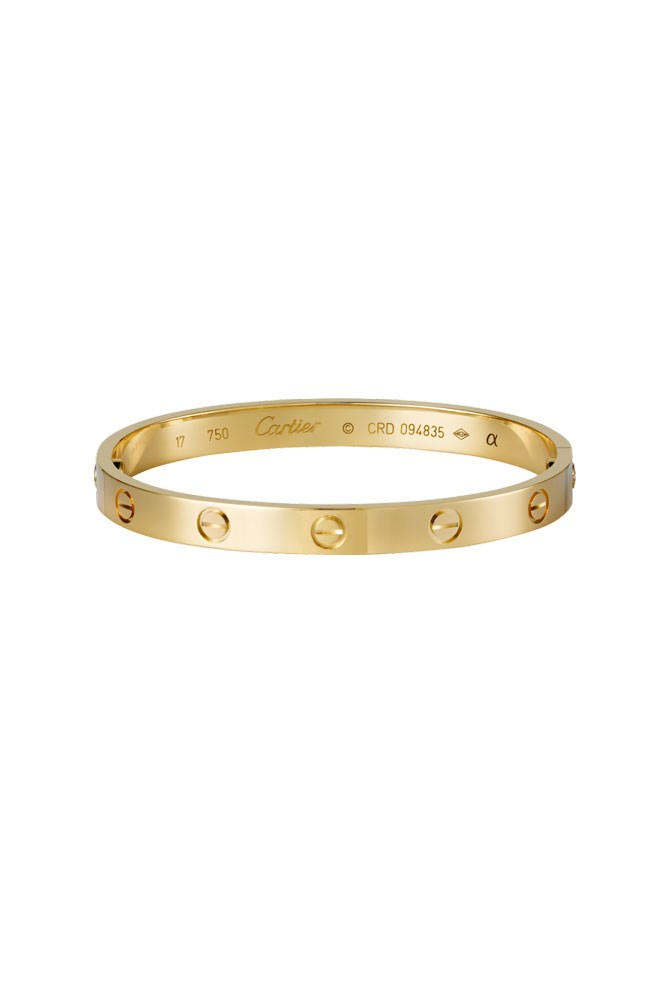 "<a href=""http://www.au.cartier.com/en-au/collections/jewelry/collections/love/bracelets/b6035517-love-bracelet.html"">18K Yellow-Gold 'Love' Bracelet, $8,800, Cartier</a>"