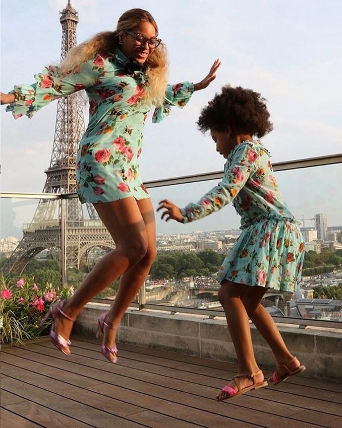Matching jumping printed Gucci dresses.