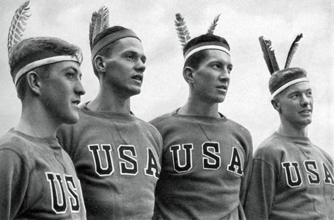 <p> <strong>1936</strong><p> <p> The American gold-medal-winning rowing team wearing headdresses in Berlin.