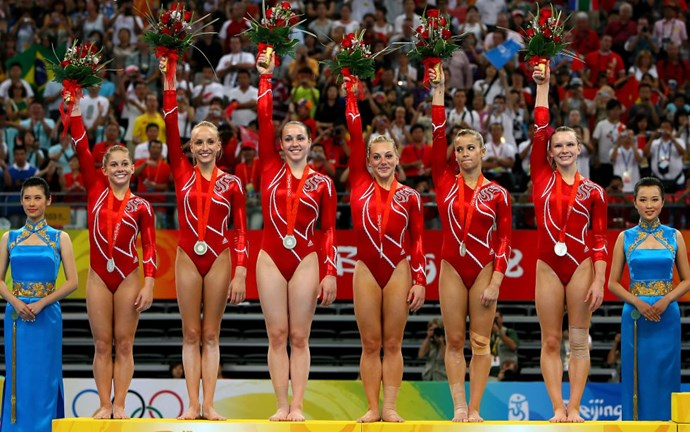 <p> <strong>2008</strong><p> <p> The U.S. women's gymnastics team after their silver medal win at the Olympic Games in Beijing. Nike and Adidas are the biggest sponsors this year, duking it out for supremacy of the games.