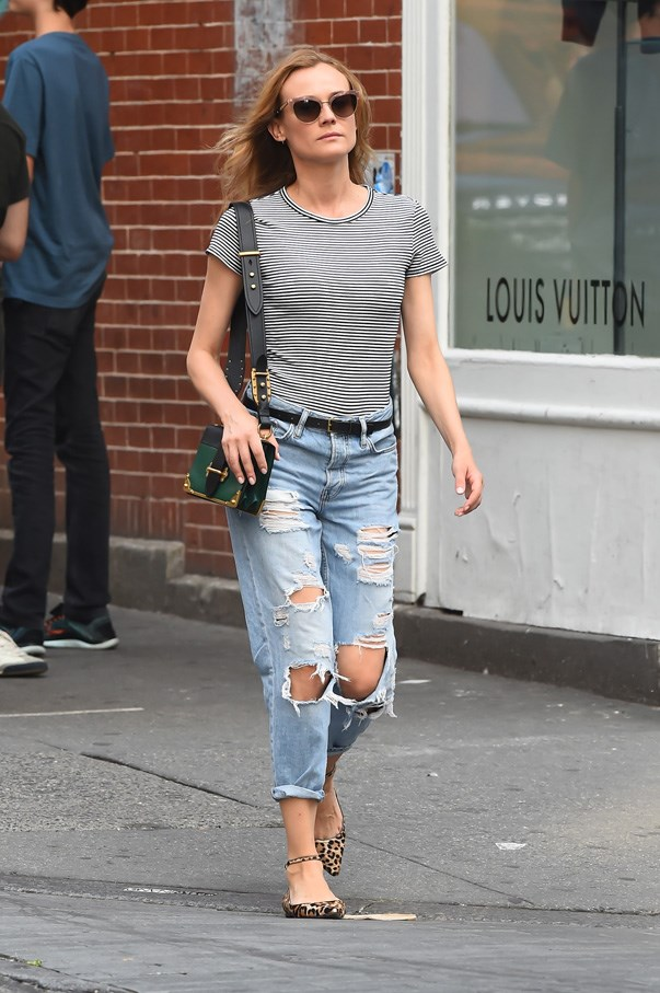 In ripped boyfriend jeans in New York.