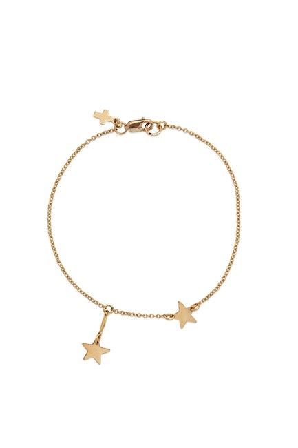 """Star Bracelet, $156, <a href=""""http://petitegrand.bigcartel.com/product/cord-glass-and-gold-charms-necklace"""" target=""""_blank"""">Petite Grand</a>."""