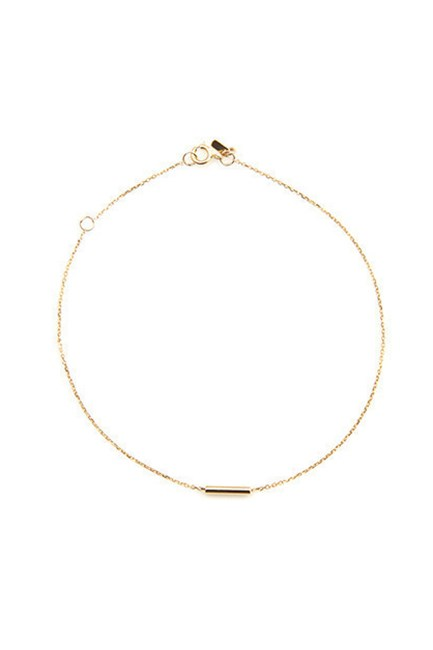 "Gold Tube Bracelet, $245, <a href=""https://www.sarahandsebastian.com/collections/women/products/tube_bracelet_yellow_gold"" target=""_blank"">Sarah & Sebastian</a>."