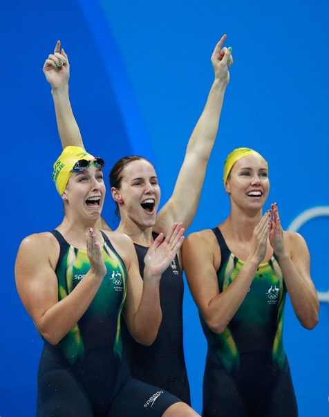Emma McKeon, Brittany Elmslie and Bronte Campbell captured at the moment they realised they had won gold and set a new world record in the women's 4 x 100m freestyle relay.