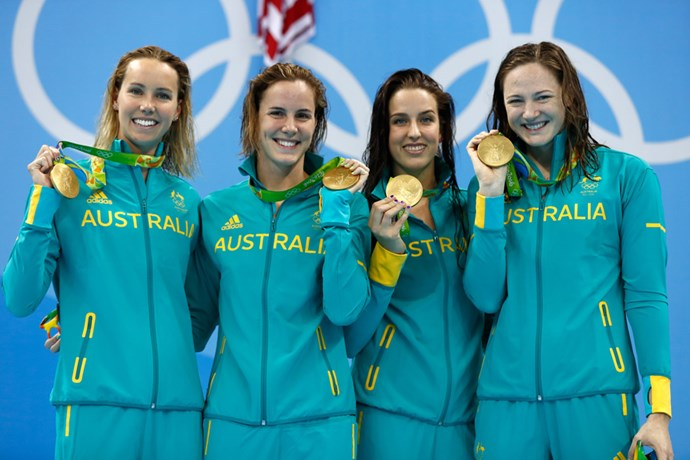 The ladies with their shiny gold medals.