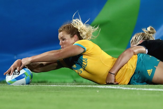 Australia's Emma Tonegato scores a try in the women's rugby sevens final.