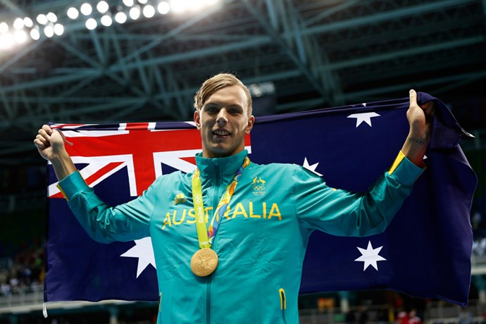 Kyle Chalmers carried the Australian flag proudly after winning gold in the men's 100m freestyle.