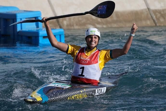 Jessica Fox celebrates crossing the finish line in the women's K1 canoe slalom final.