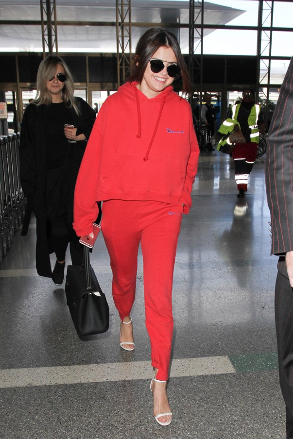 Lessons in how to dress up your tracksuit with heels, by Selena Gomez.