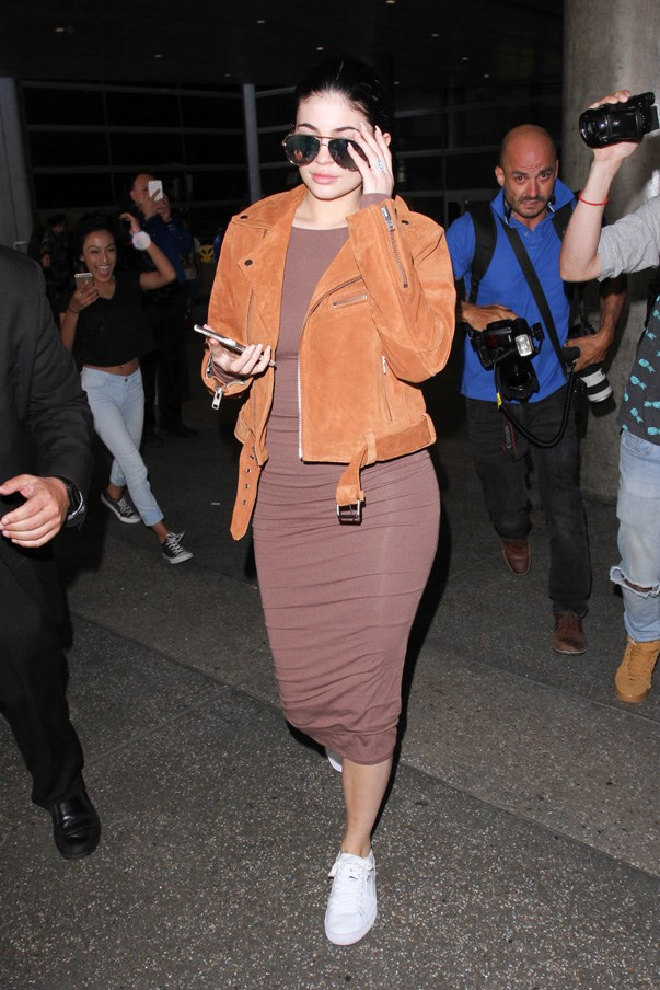 A comfy jersey dress and sneakers are Kylie Jenner's airport go-to.