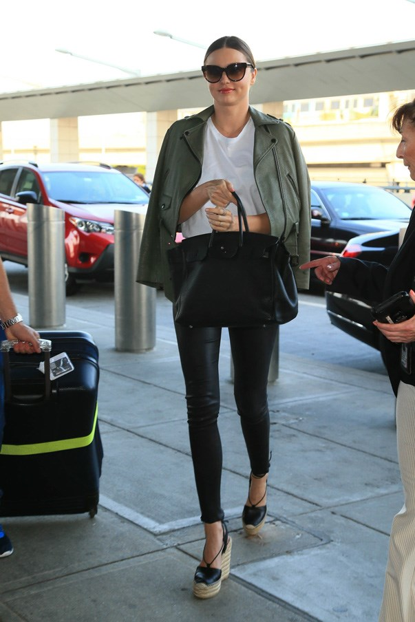 Miranda Kerr always looks polished at the airport. Just look at that jacket-on-the-shoulders action.