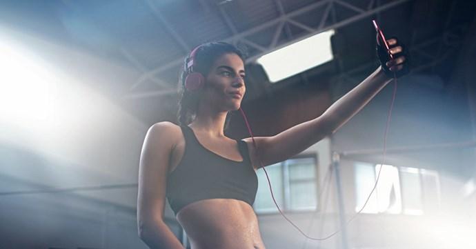 Fitness Model Taking Selfie at Gym