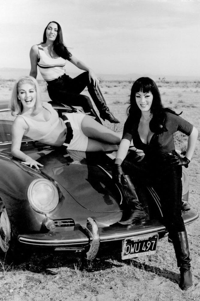 <strong>The girls of <em>Faster, Pussycat! Kill! Kill! </em>(1965)</strong><br> Varla, Billie and Rosie (Tura Satana, Lori Williams and Haji), the wasp-waisted women of B-movie <em>Faster, Pussycat! Kill! Kill!</em> are women not to be messed with. In a race or out of one. Driving a very cool Porsche356c, the trio turned the '60s trope of women as flag wavers only and gave them heightened sexuality and a need for speed and danger. The ladies in this trio are the epitome of super-vixens.