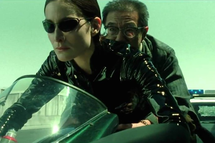 <strong>Trinity, <em>The Matrix</em> (1999)</strong><br> Dressed in her patent leather cat suit, wrap-around glasses and slicked back helmet-like hair, Trinity rode her hot Ducatti 996 like it was an extension of her being.