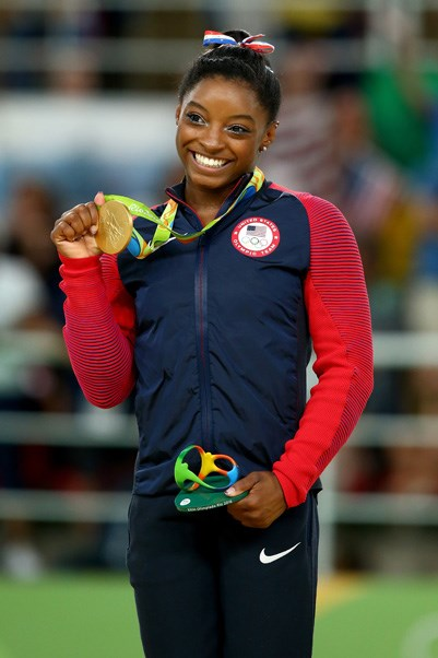 <p><strong>USA:</strong> Approx. $33,000 AUD. <p>Pictured: Simone Biles after winning the women's floor gymnastics event.