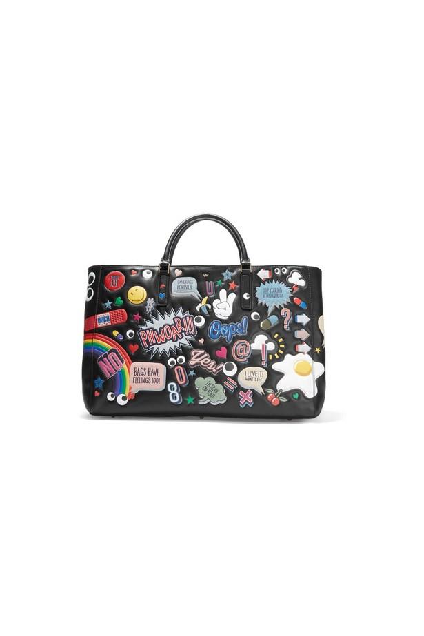 "Bag, $4431, <a href=""https://www.net-a-porter.com/au/en/product/651732/Anya_Hindmarch/ebury-maxi-all-over-stickers-leather-tote"">Anya Hindmarch via net-a-porter.com</a>"