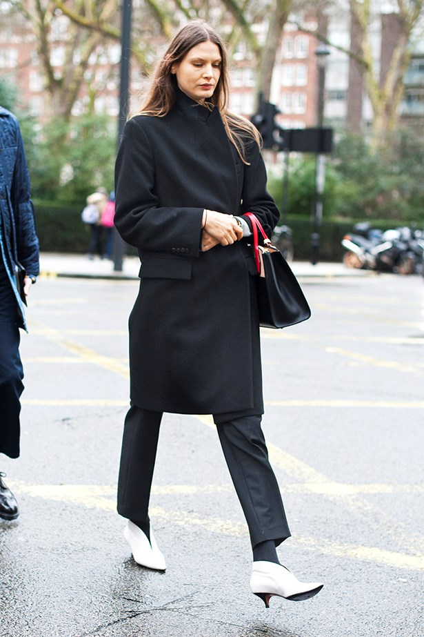 """One way to opt out of another all-black outfit? Give a nod to the '80s by adding white booties - This Céline pair are heaven."""
