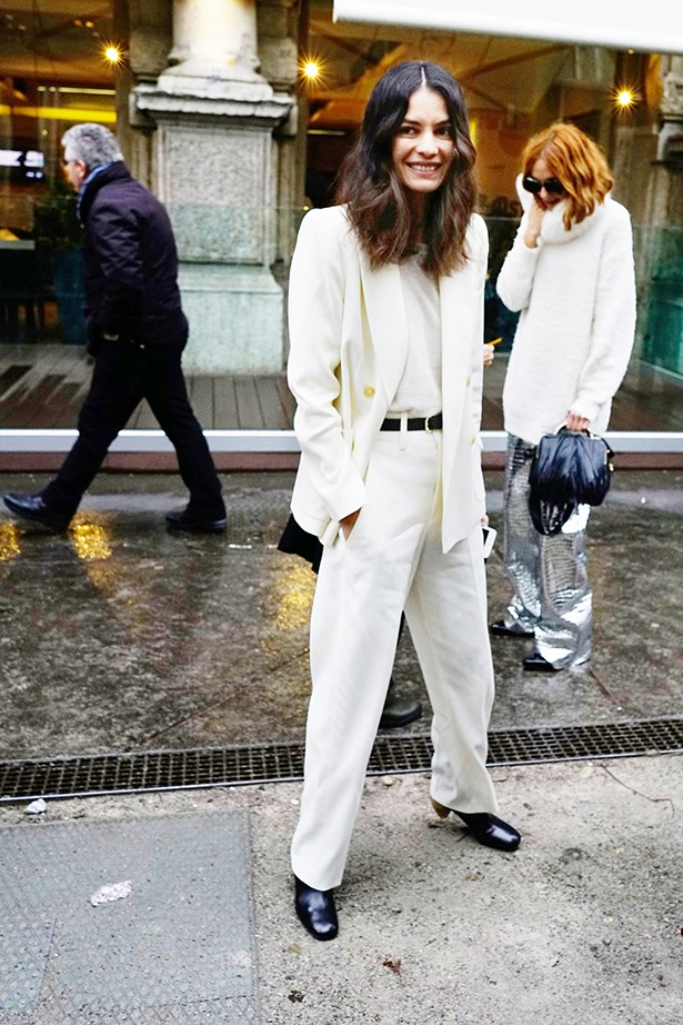 """Stylebop fashion director Leila Yavari looks super-polished in a white tailored suit and top, yet still comfortable in the exaggerated silhouettes. #win."""