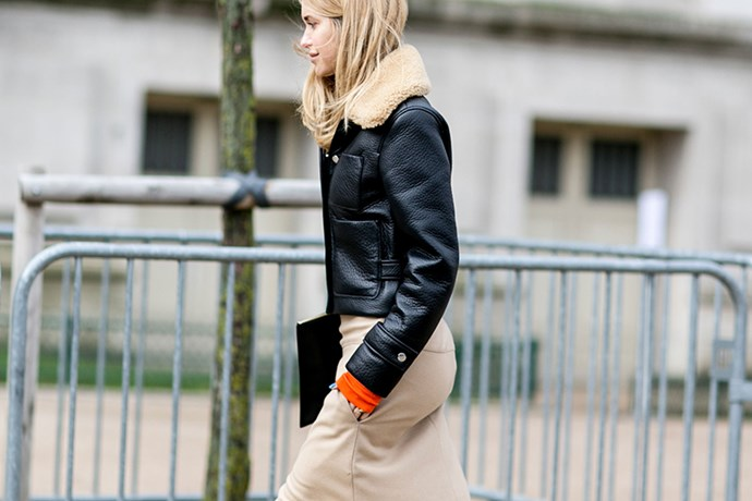 """If Danish blogger Pernille Teisbaek has a style flaw, I've never seen it. Here, she schools us on how to wear a shearling leather jacket (note the perfectly placed pop of colour)."""