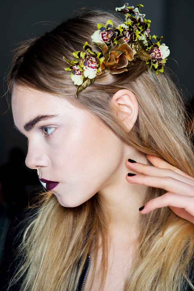 model backstage at fashion show beauty look