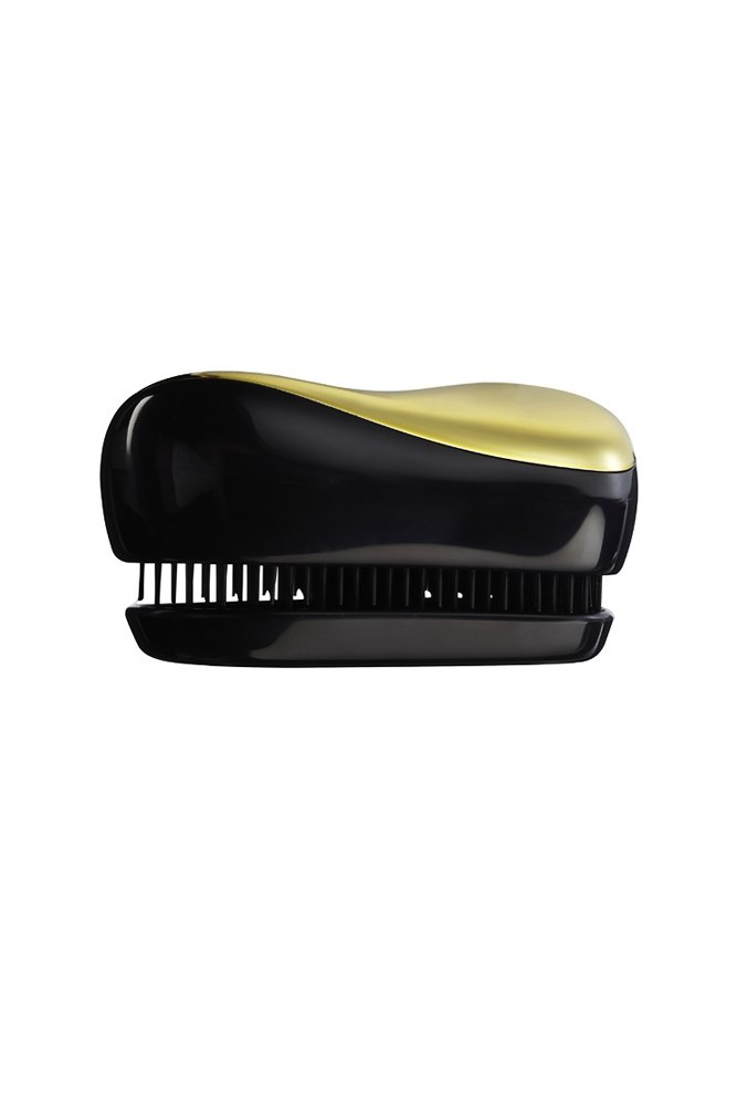 """<strong>Hair brush</strong><br> Consider a compact, clutch-sized hair brush your race day MVP.<br> <em><a href=""""http://www.asos.com/au/Tangle-Teezer/Tangle-Teezer-Compact-Styler-Professional-Detangling-Brush/Prod/pgeproduct.aspx?iid=1210294"""">Compact Styler Professional Detangling Brush, $27, Tangle Teezer</a></em>"""
