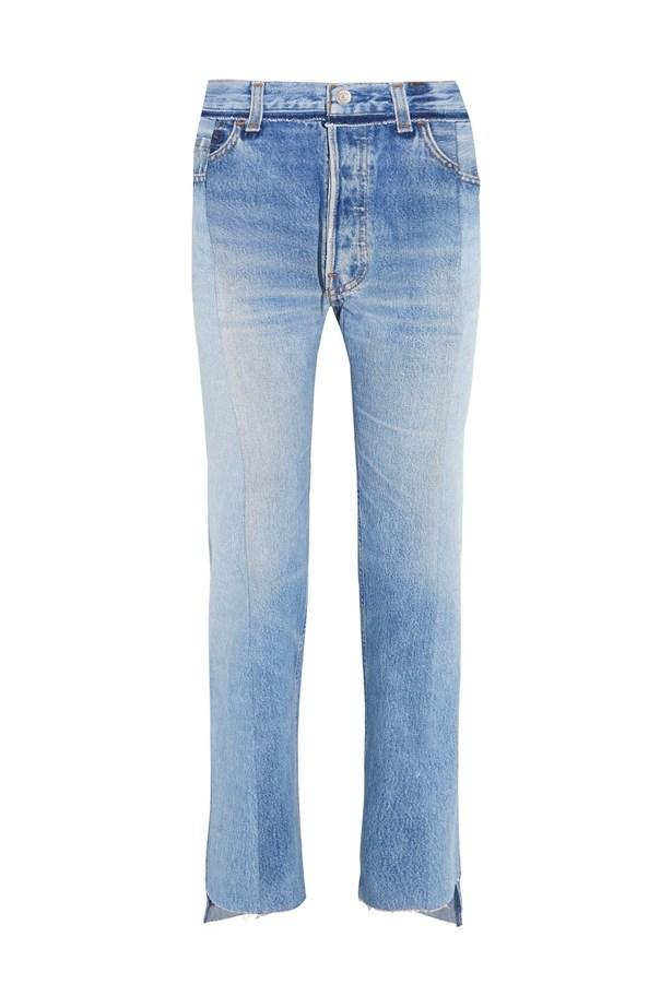 "Jeans, $1,456, <a href=""https://www.net-a-porter.com/au/en/product/757195/vetements/reworked-high-rise-slim-leg-jeans"">Vetements at net-a-porter.com</a>."