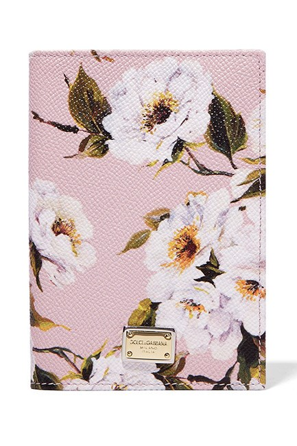 "<strong>A luxe passport cover.</strong> <br><br>So that she can always travel in style. <br><br>Passport Cover, $485, <a href=""https://www.net-a-porter.com/au/en/product/753514/dolce___gabbana/printed-textured-leather-passport-cover"">Dolce & Gabbana at net-a-porter.com</a>"