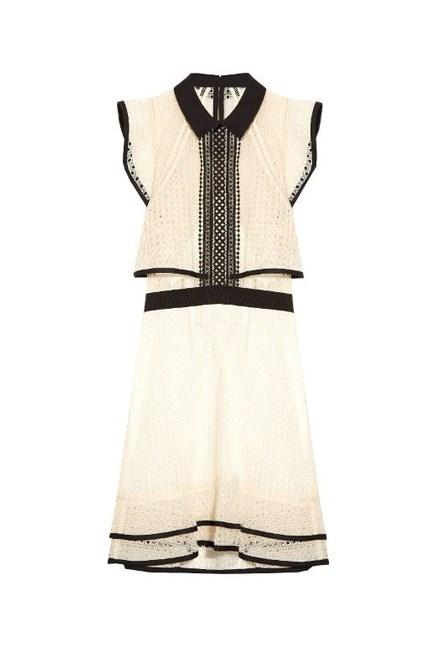 "Ruffled Broderie Anglaise Organza Mini Dress, $347, <a href=""https://www.net-a-porter.com/au/en/product/714101/Self_Portrait/ruffled-broderie-anglaise-organza-mini-dress"" target=""_blank"">Self Portrait at net-a-porter.com</a>."